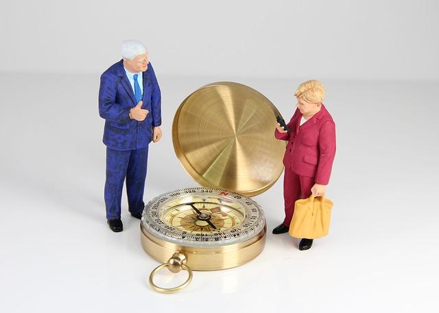lidé u kompasu